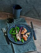 Bacon-wrapped quail with braised Treviso radicchio and sugar snaps (low carb)