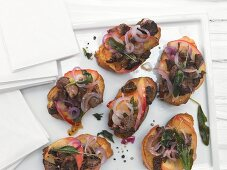 Italian chicken liver crostini with grilled apples and sage