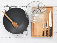 Kitchen utensils for making prawns in an egg white coating with baby corn cobs, snow peas and shiitake mushrooms