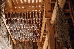 Bacon and sausages in the curing chamber at the Hofmanufaktur Kral in South Tyrol