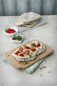 A focaccia with soft cheese, cherry tomatoes and cress