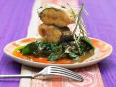 Fish with coconut, tamarind, fried ginger and spinach