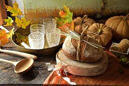 Fall diner celebration in the country, decorations with country bread wooden spoons and pumpkins