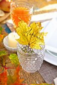 An autumnal dinner celebration with a leaf place setting