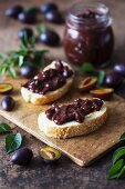 Homemade plum jam on toasts