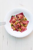 Beetroot ravioli with walnuts and a ricotta filling