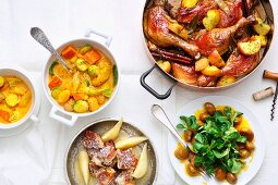 A Christmas meal with roast legs of duck, winter curry and shredded sugared pancake with nuts