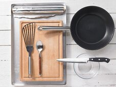 Kitchen utensils for making veal tagliata with green asparagus