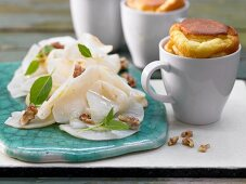 Potato souffles with truffle oil and a celery and walnut salad