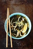 Asian-style chicken broth with wakame and lemon