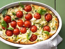 Clafoutis with tomatoes, peas, ricotta and basil