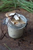 Hearty wild mushroom soup with potatoes in a glass jar