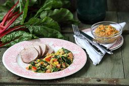 Pork fillet with curried chard and red lentils