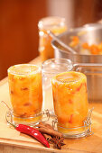 Pumpkin and apple chutney in a glass as a Christmas gift