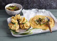 Pancake parcels filled with mushrooms and spring onions