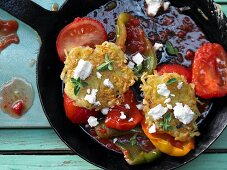Potato and feta pancakes with stewed peppers and oregano