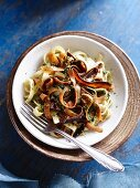 Carrot noodles with basil and walnut pesto