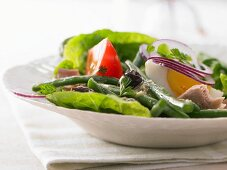 Salad niçoise with tuna, green beans and eggs in a mustard vinaigrette