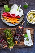 Swiss chard rolls with pickled carrots and hummus
