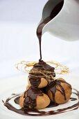 A profiterole, cream puff or choux a la creme