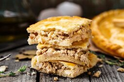 Delicious homemade pie stuffed with chicken and eggs