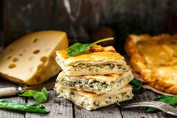 Delicious homemade pie stuffed with cheese and spinach