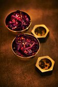 Red cabbage with pepper grains and pomegranate seeds