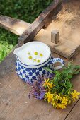 A jug with quark and flowers