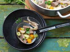 Swabian style beef stew, with tafelspitz (boiled beef), vegetables and spaetzle noodles