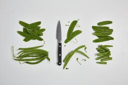 Sugar snaps and green beans being washed and chopped (step by step)