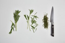 Rosemary being chopped (step by step)
