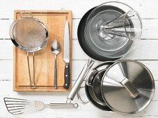 Kitchen utensils: Pots, pan, measuring cup, sieve, spatula