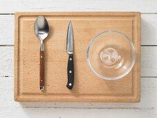 Kitchen utensils: spoon, kitchen knife, glass bowl