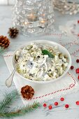 Herring with onions and apples in sour cream