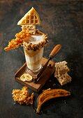 Banana and vanilla milkshake with caramel cream and crunchy decorations