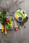 An arrangement of chard, broad beans, nectarines and blueberries
