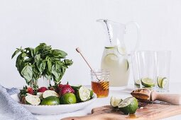 The ingredients for Honey Sweetened Limeade with Strawberries and Basil