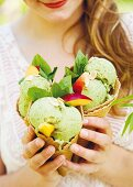 Basil ice cream with nectarines and almond flakes