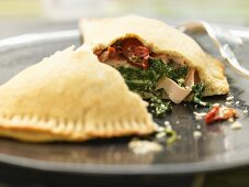 Calzone with spinach and smoked mozzarella
