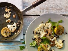 Fried cauliflower with anchovies, capers and olives