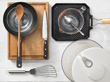 Kitchen utensils: pan, grill pan, salad bowl, spatula, a measuring cup