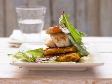 Carrot and potato rosti with mussels and sesame seeds
