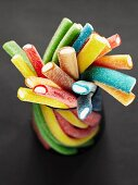 Stack of coloured gummy sweet sticks