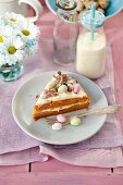 Carrot cake with orange cream and chocolate eggs