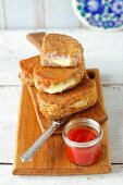 Fried bread sandwiches with mozzarella and bacon