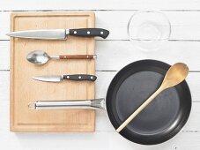 Various kitchen utensils: pan, spoon, knives