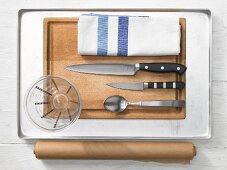 Kitchen utensils for preparing John Dory fish