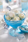 White chocolate pralines in a blue glass dish for Christmas