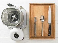 Kitchen utensils for making a mango drink