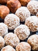 Homemade peanut butter energy protein balls with coconut flakes